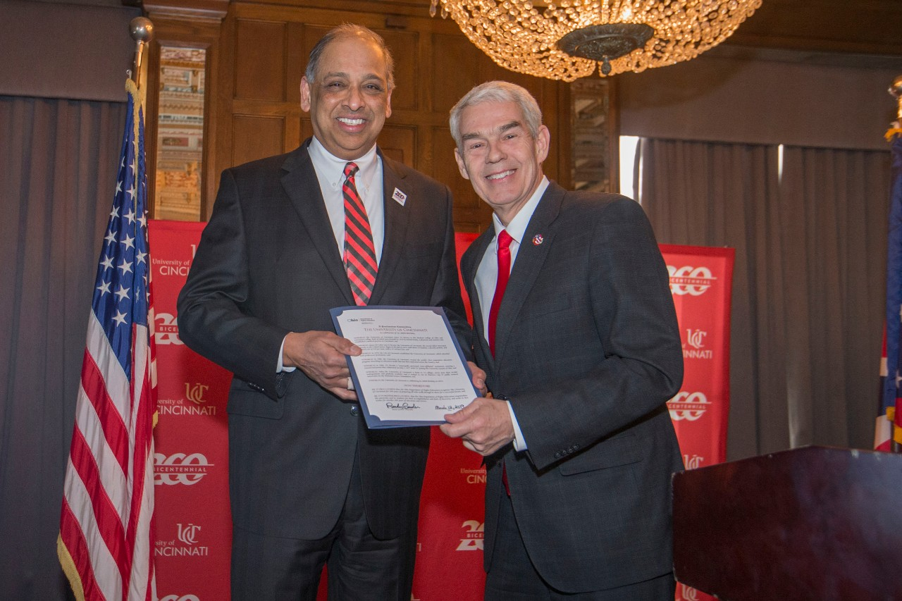 Neville G. Pinto, left University of Cincinnati president and Chancellor Randy Gardner posed with proclamation during the Bicentennial Commendation & Reception at the Athletic Club in Columbus, Ohio.