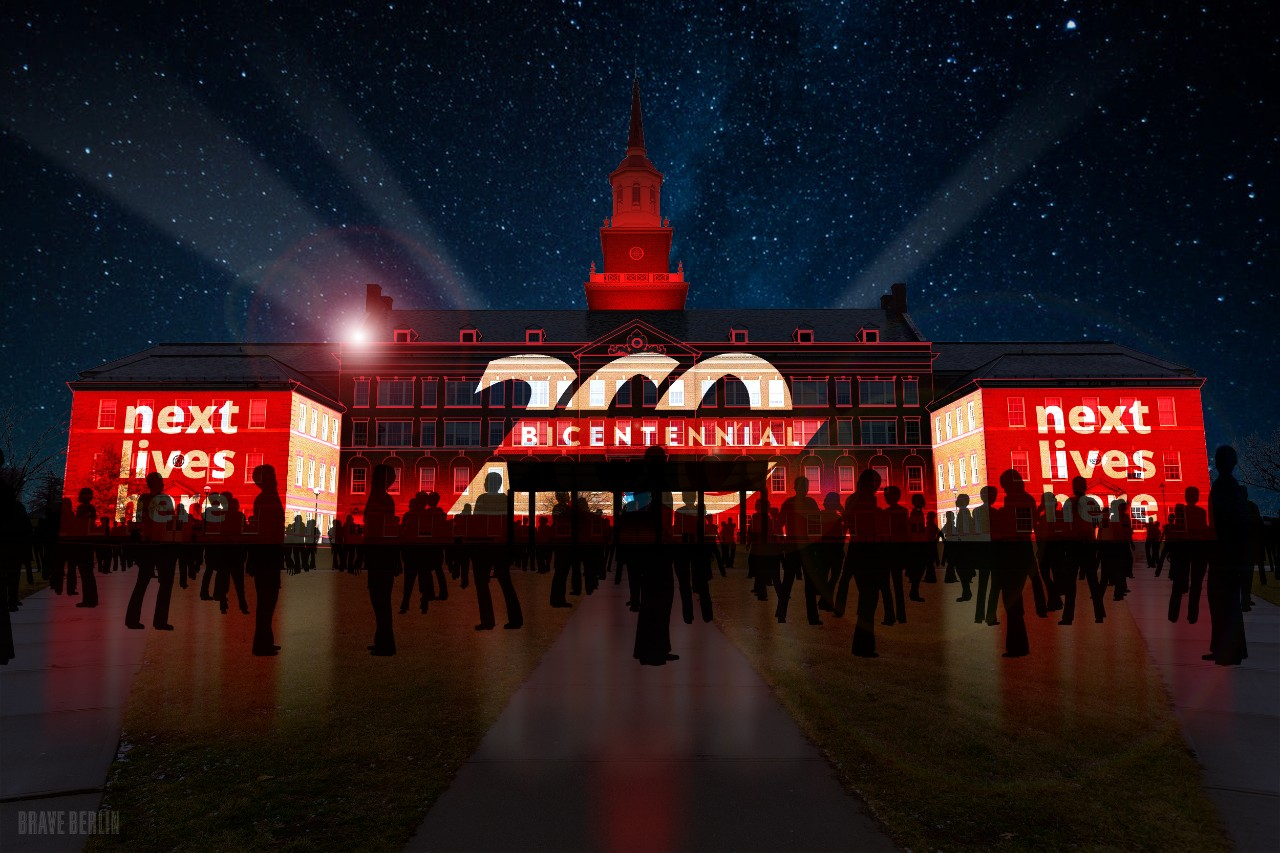 McMicken Hall with light show on building