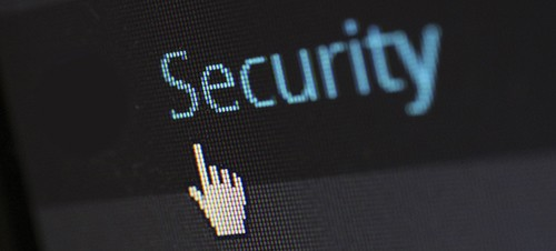 """computer screen with the word """"security"""" and a hand pointing icon"""