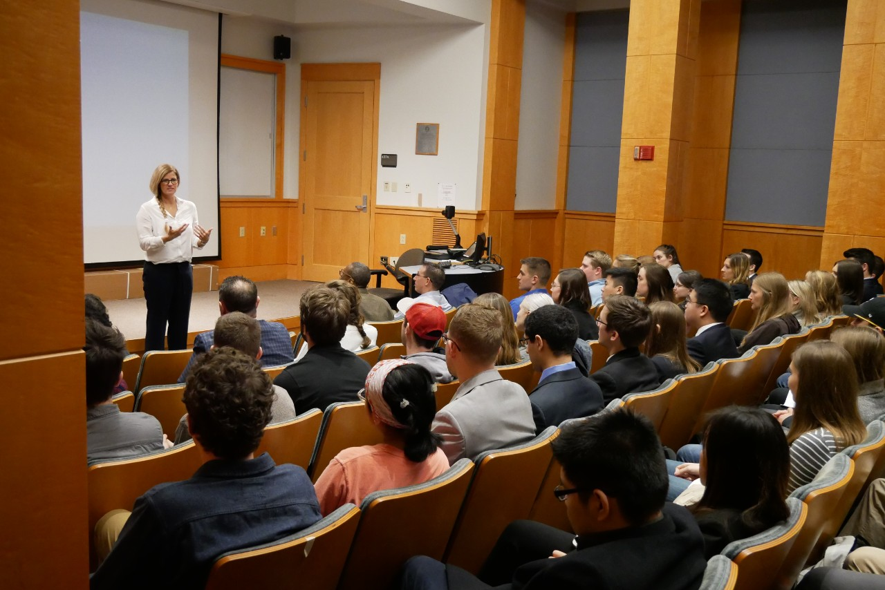 Mary Beth Privatera addresses a class in an auditorium.