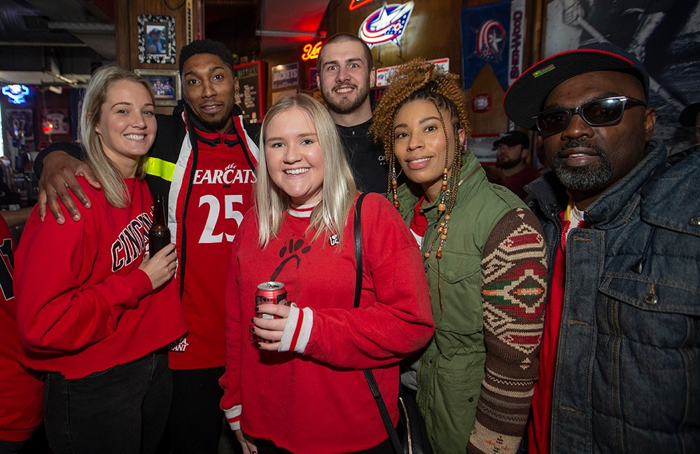 UC fans pose at a bar before the game.