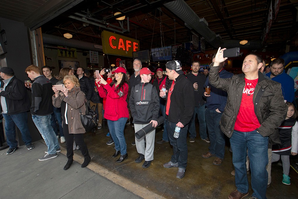 UC Fans take pictures outside the arena