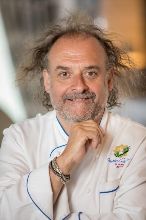Head shot of Chef Jean-Robert de Cavel
