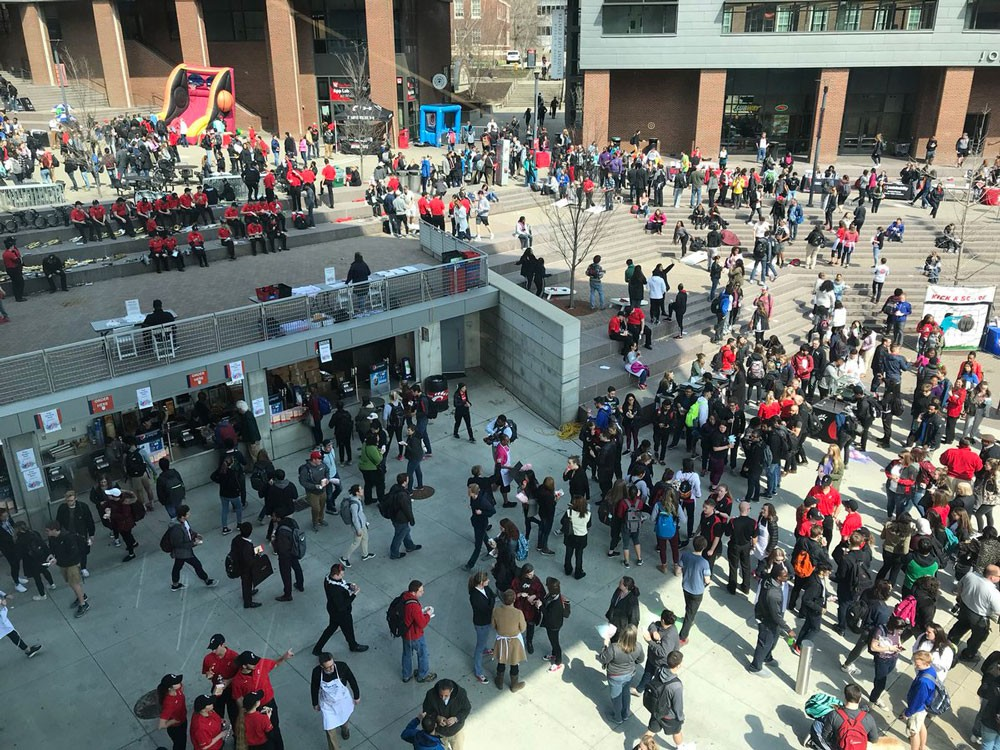 Students gather on Main Street for the Bearcat Block Party on the main campus of University of Cincinnati.