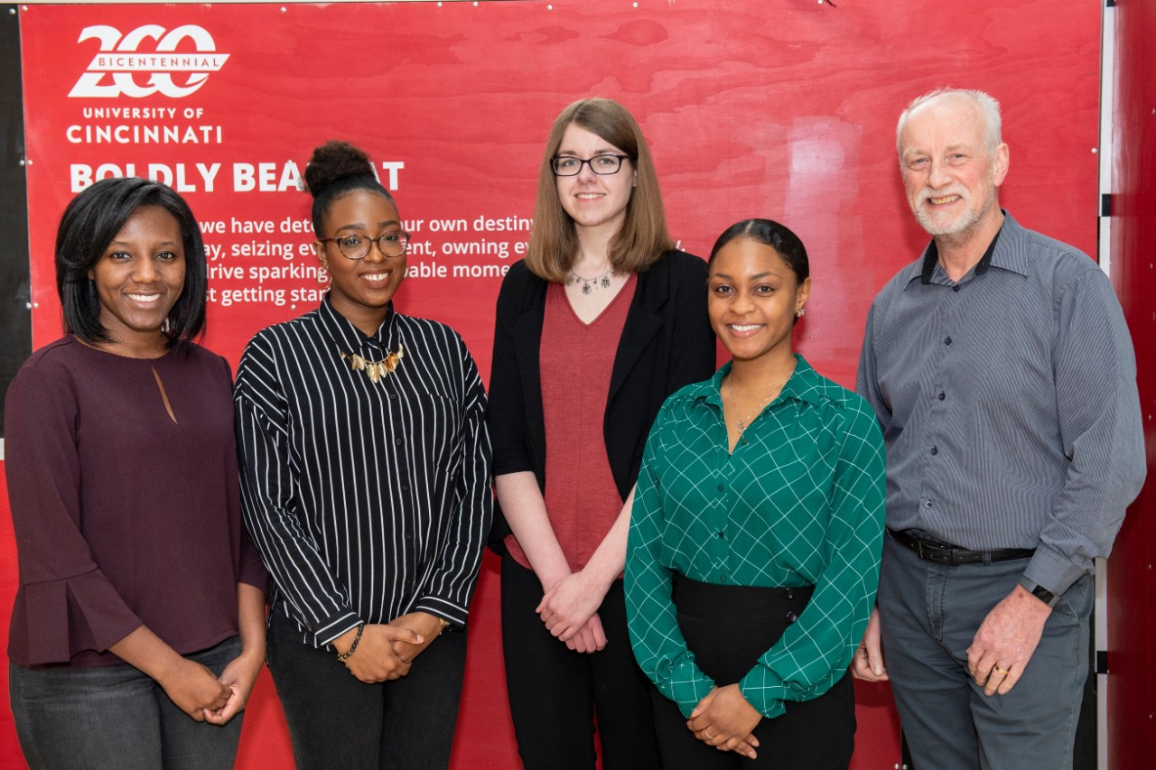 Four UC students shown with Iain Cartwright, PhD, in the College of Medicine.