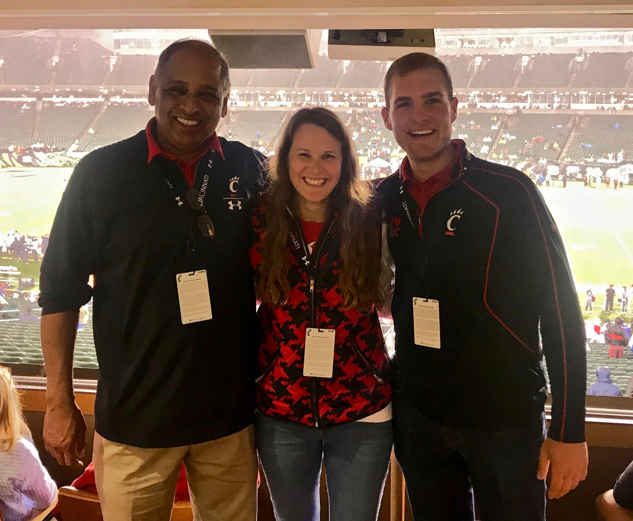 UC President Neville Pinto, PLME student Kendall Cappel and Lindner IT student Kevin Thomas stand together in Paul Brown Stadium.