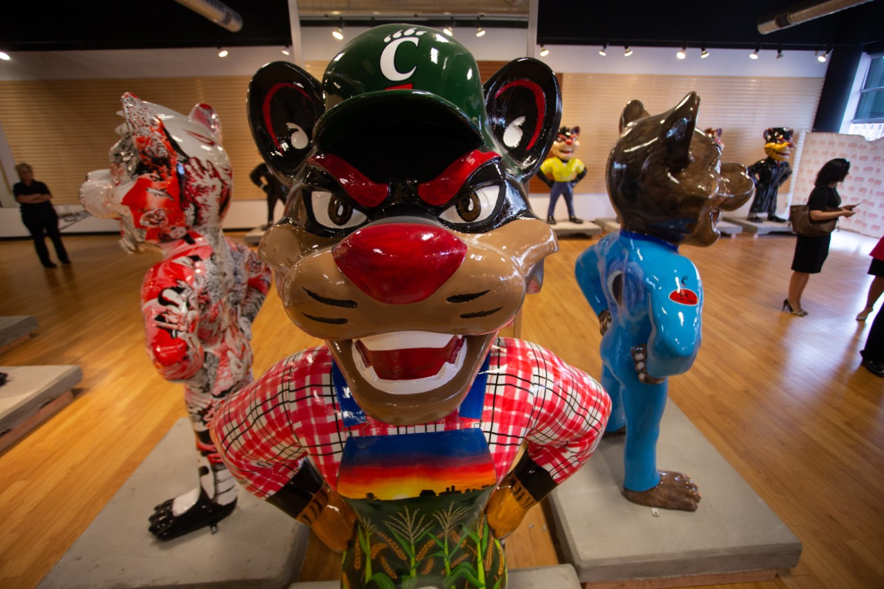 Frontal view of a statue of a Bearcat decorated as a farmer