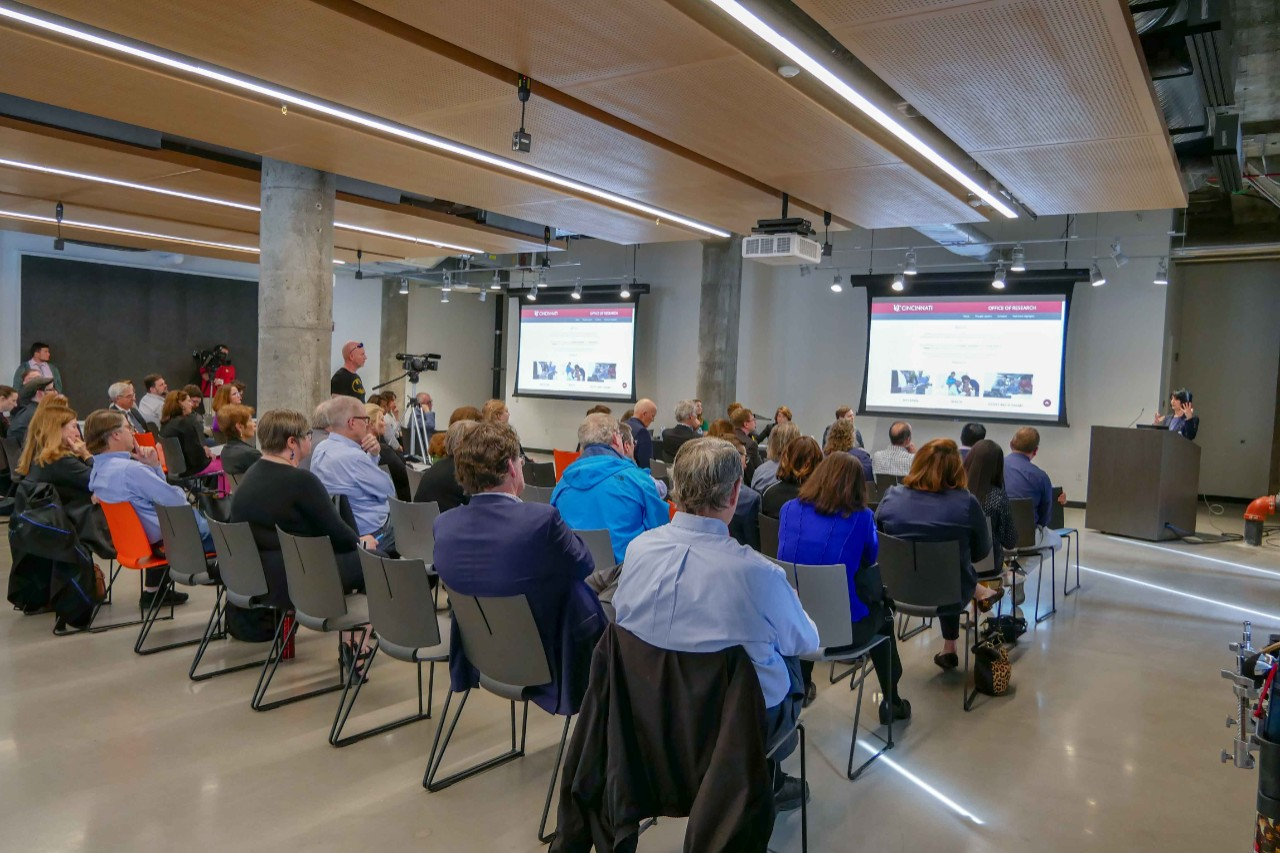 wide shot of room in innovation hub with panelists and attendees at event