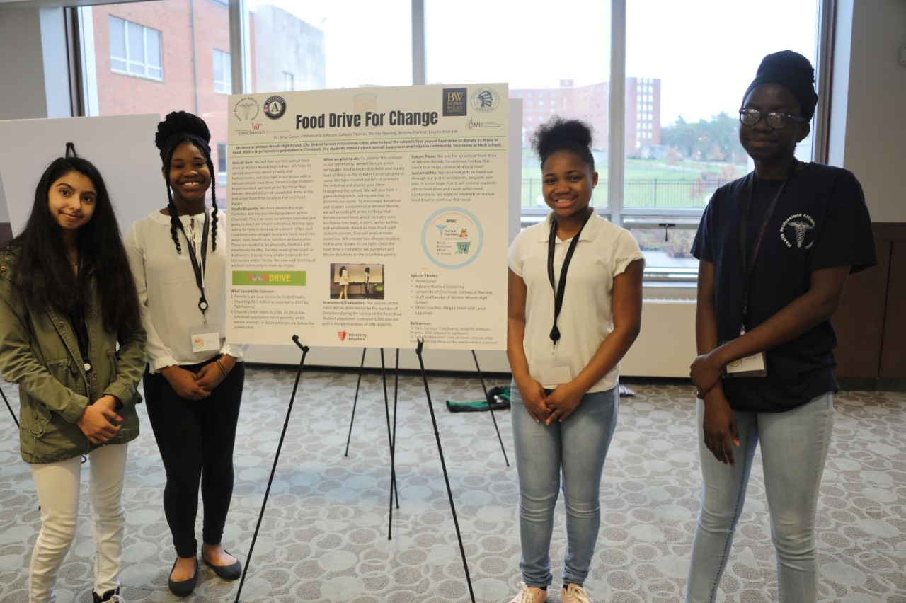 Students from Winton Woods High School by their poster presented at the second annual Southern Ohio Scholars Day March 30, 2019