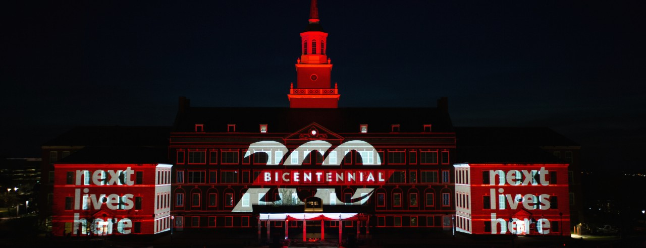 University of Cincinnati 200 Bicentennial and Next Lives Here displayed on McMicken Hall during Community Day to celebrate UC's Bicentennial Saturday April 6, 2019 at McMicken Commons on the campus of the University of Cincinnati. Photo by Andrew Higley/University of Cincinnati