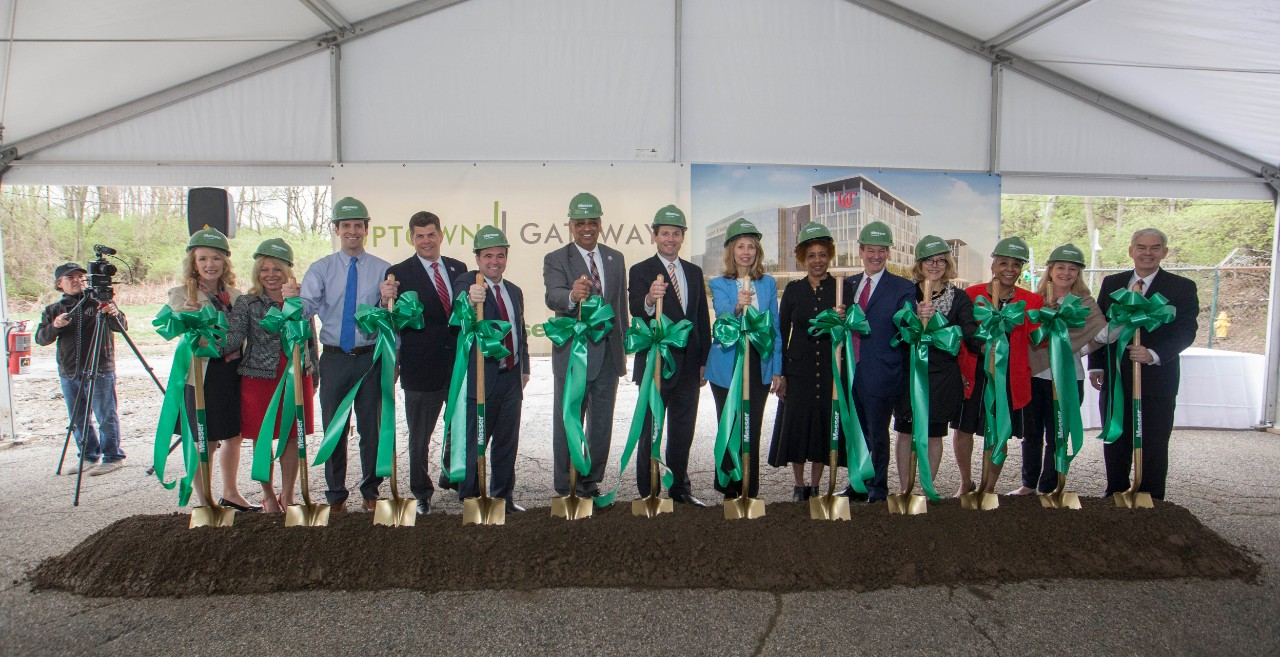 Officials with shovels at the groundbreaking event for the Uptown Gateway