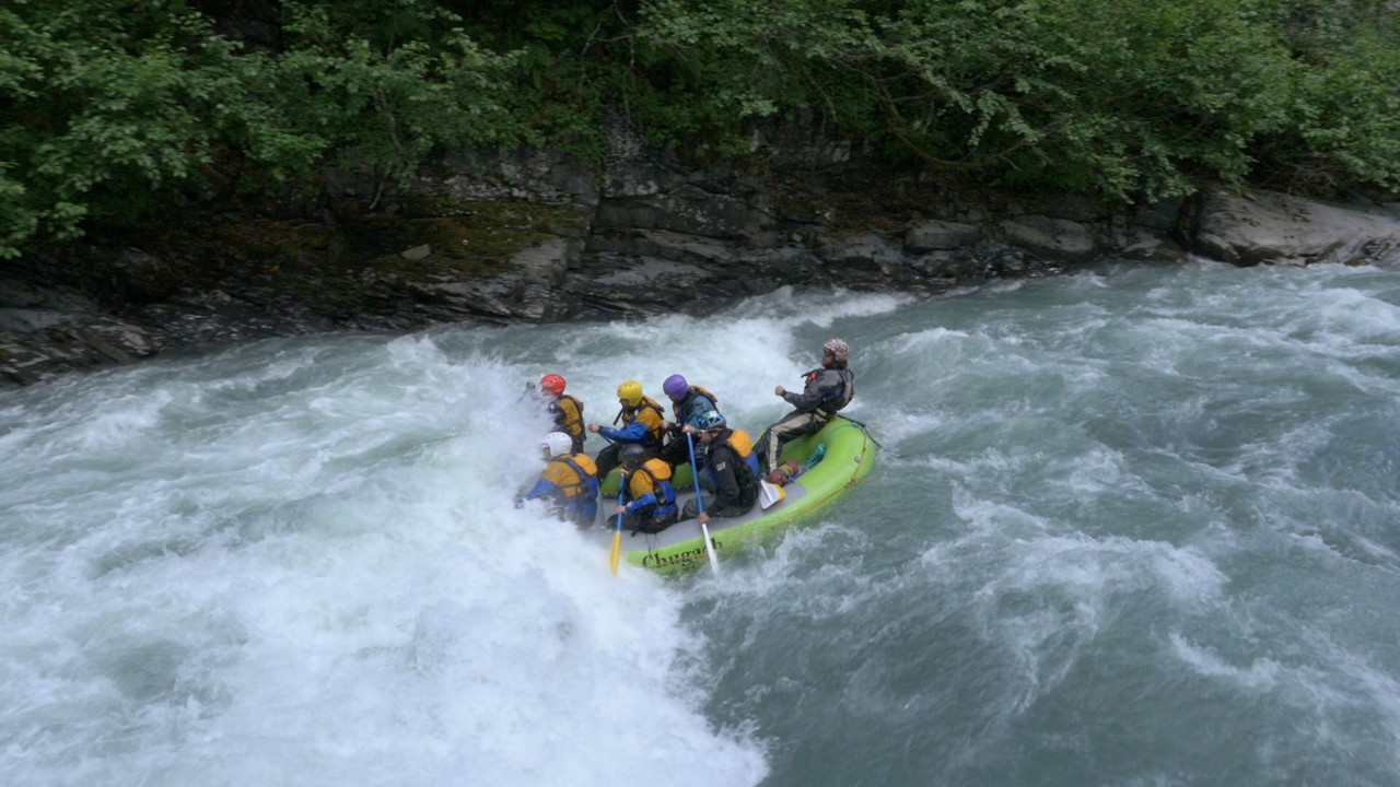 A team of adventure racers rafts down a river in Alaska.
