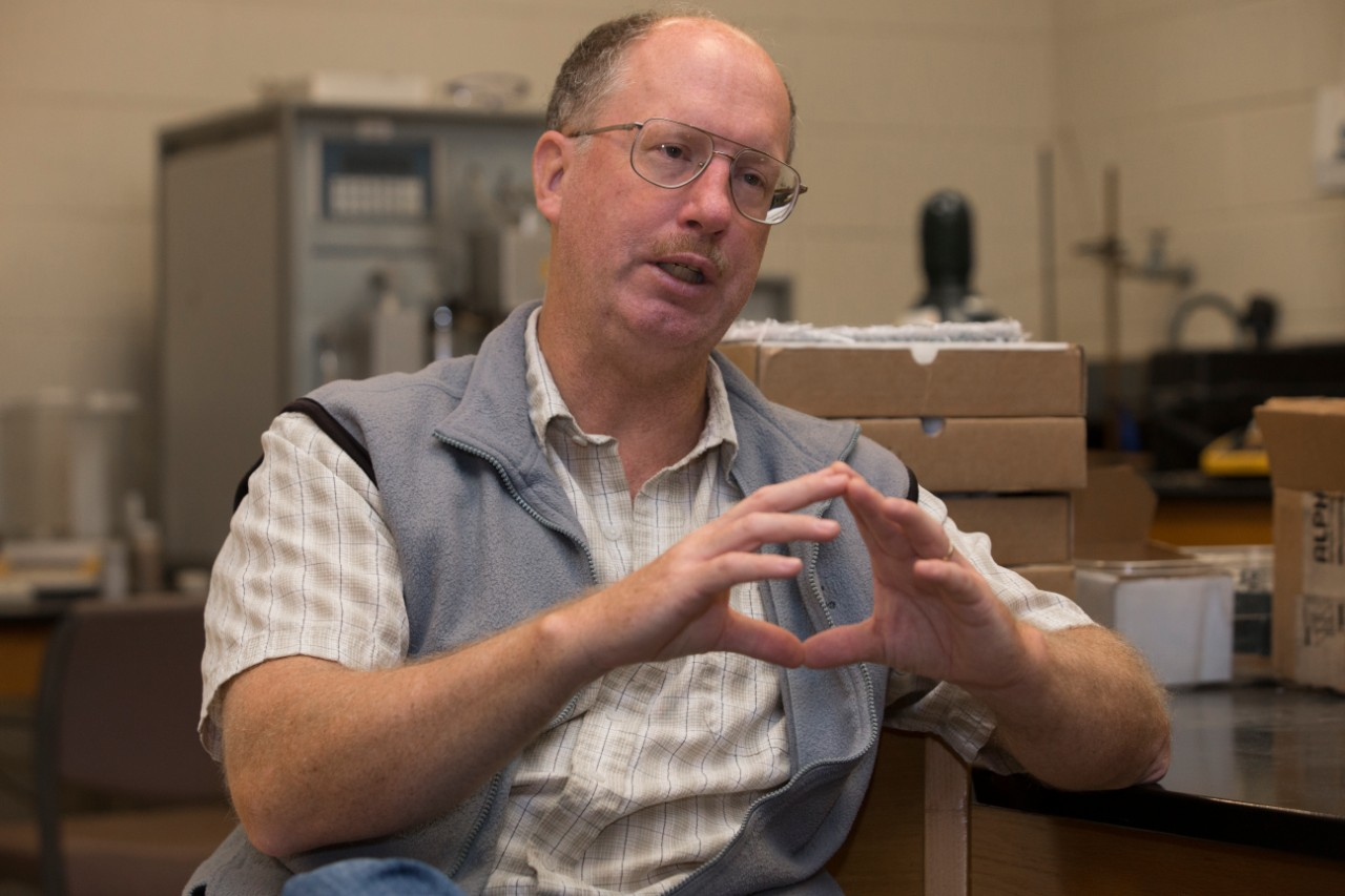 UC professor Thomas Algeo gestures while talking in a geology lab.