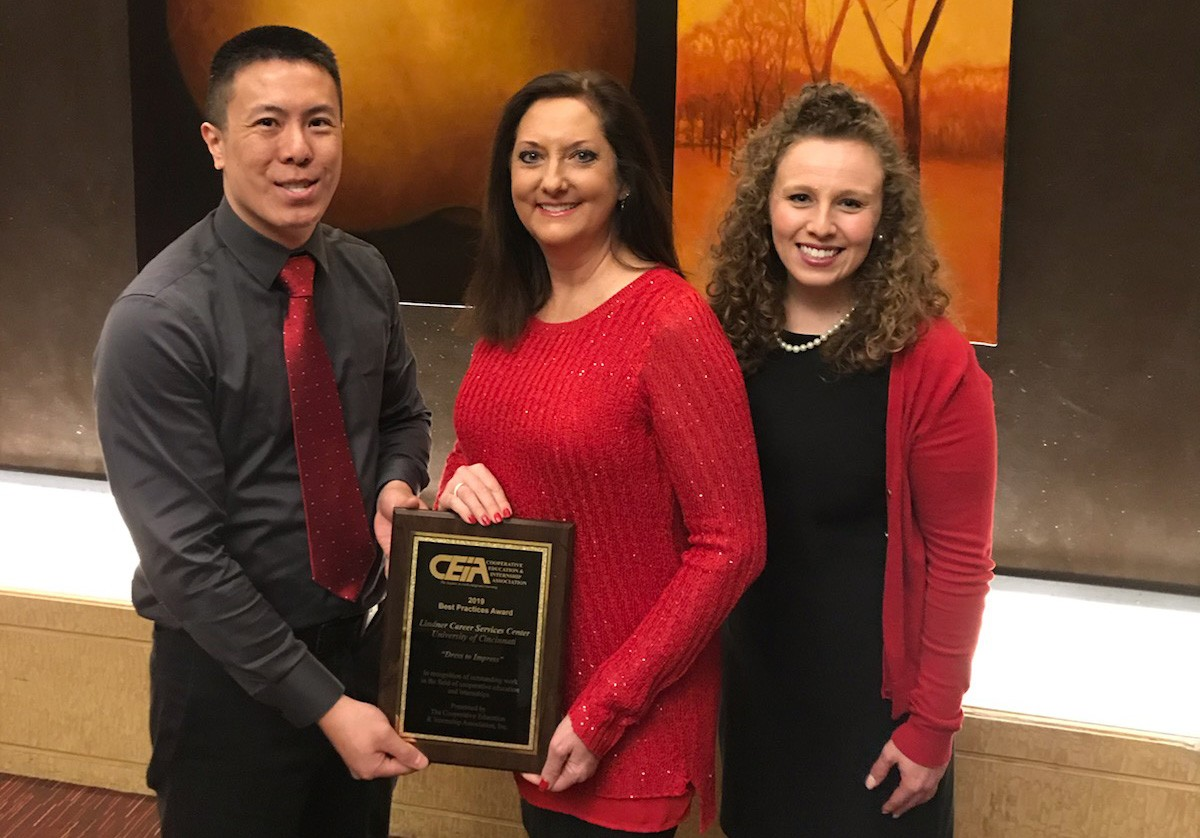 (L to R): Keith Sun, Lisa Forbes, and Amy Marcrum pose with the 2019 CEIA Best Practice Award plaque