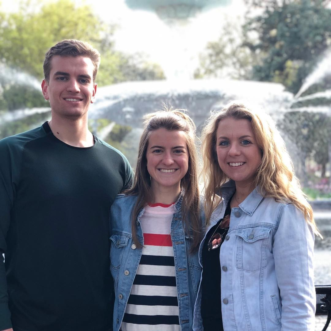 Scottie Emmert shown with his sisters, Annie Emmert, a nursing student at UC, and Betsy Emmert, a UC law school student.