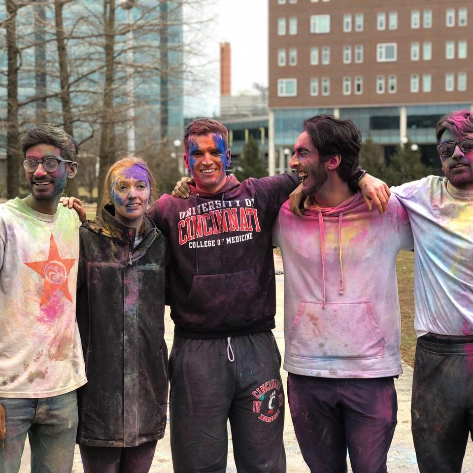 Scottie Emmert (center) is shown with friends at a UC event celebrating the Hindu festival Holi.