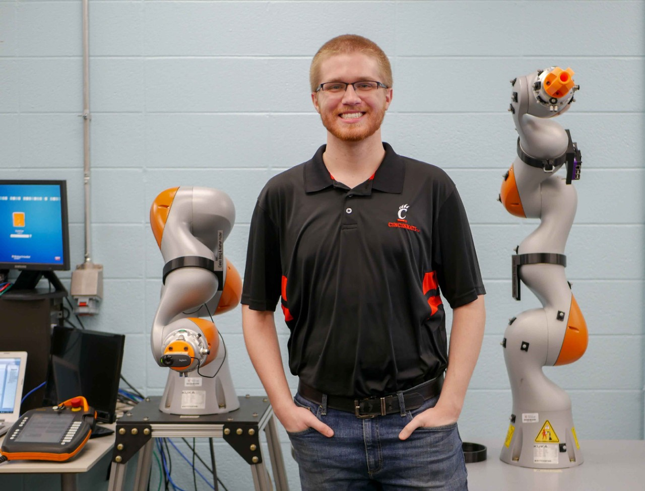 Huber stands in front of robots