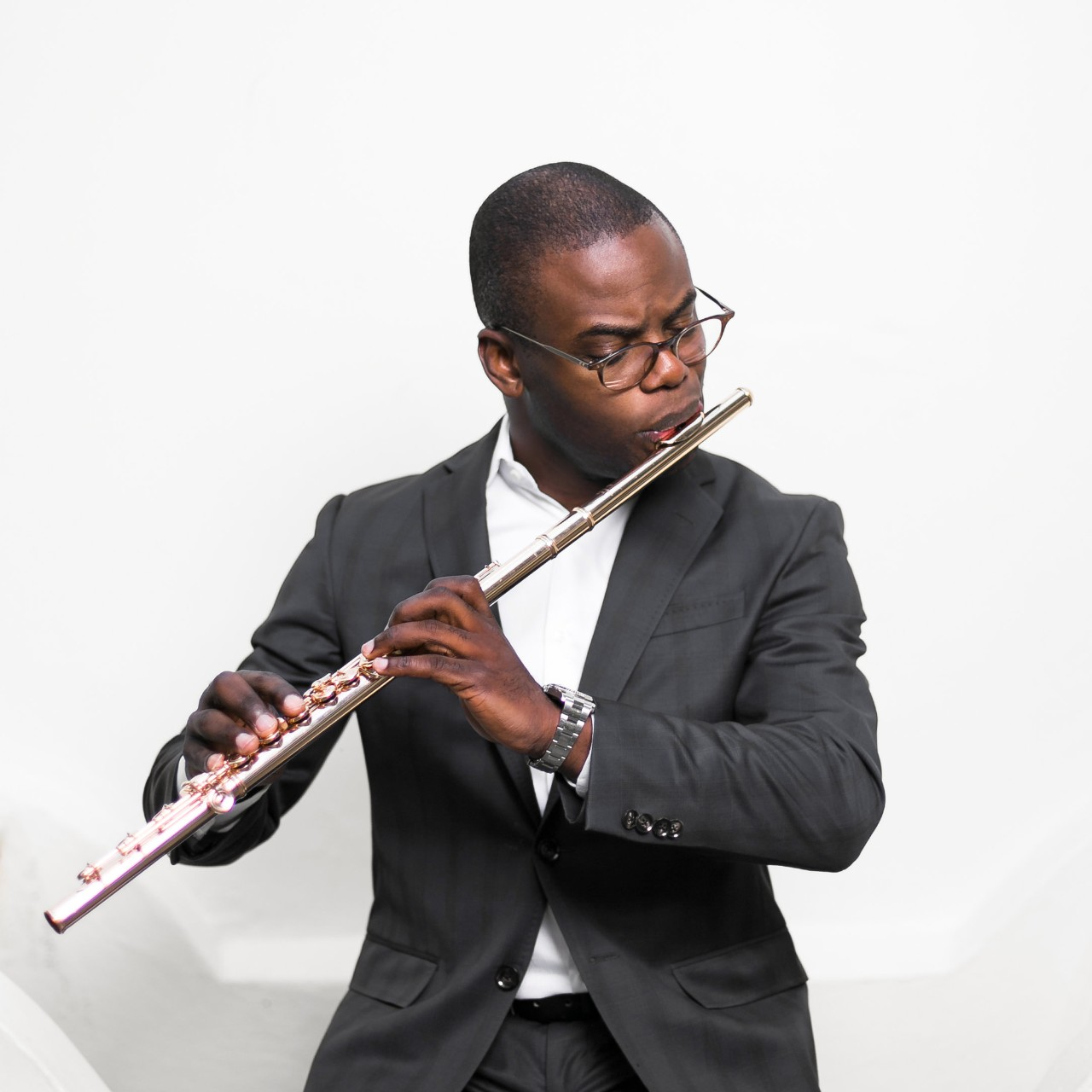 Demarre McGill performing with his flute.