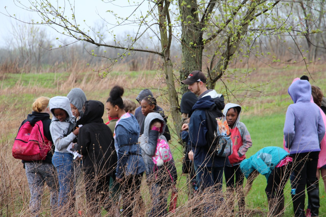 UC graduate student Cory Perfetta leads a group of SCPA students on a field trip hike.