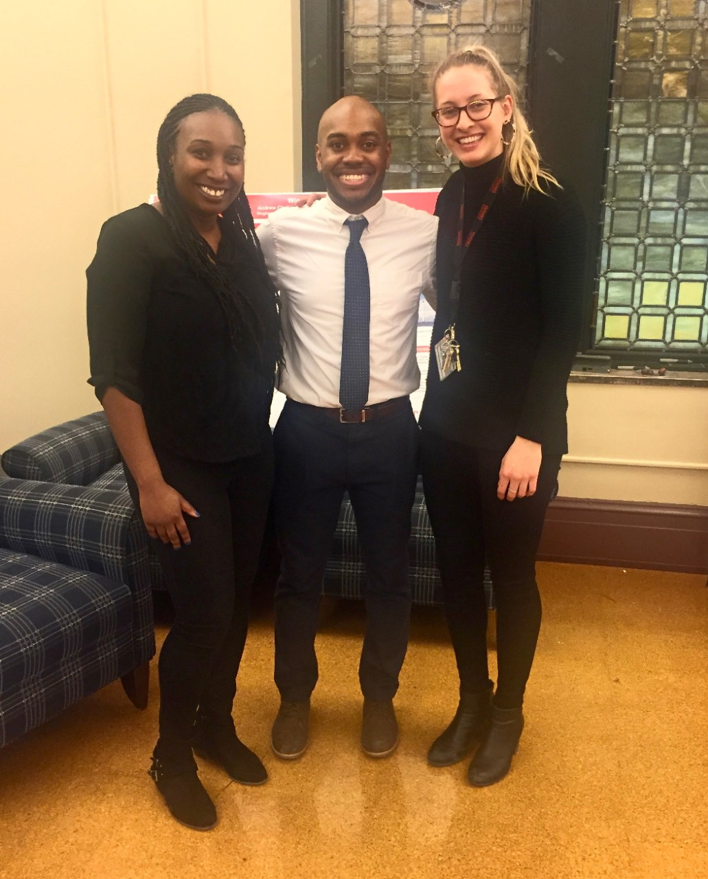 Rickey Terrell stands with two women from Hughes High School's Engineering Pathway program.