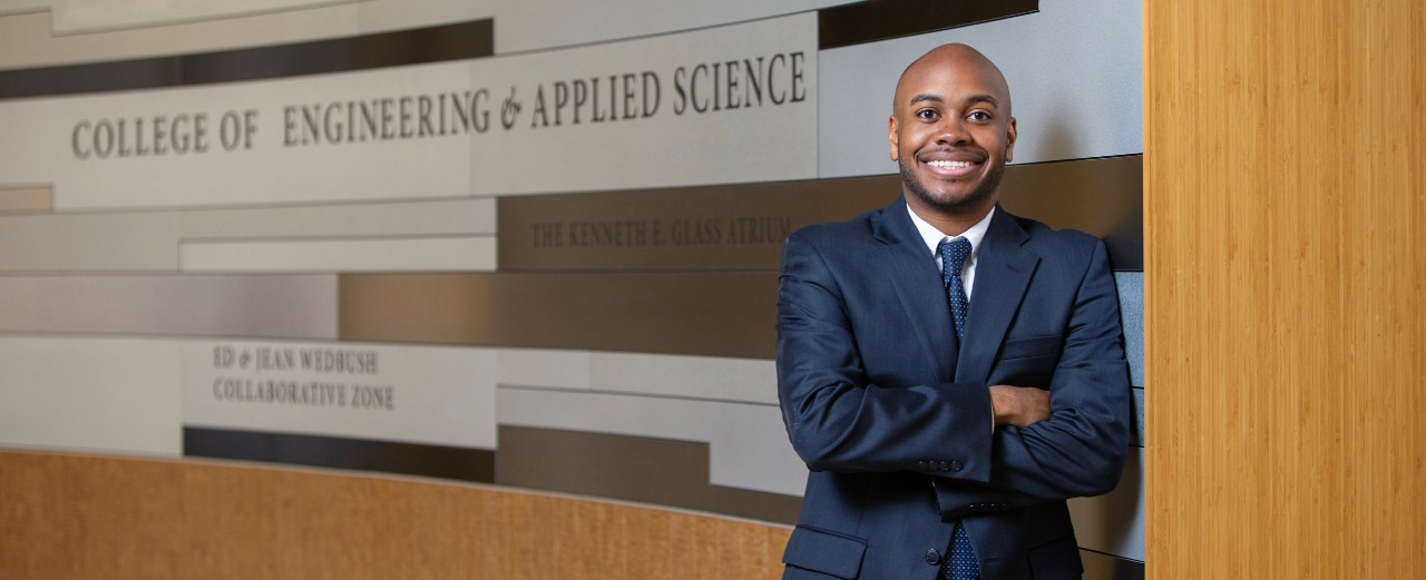 UC engineering student Rickey Terrell stands  in the hall of UC's College of Engineering and Applied Science.