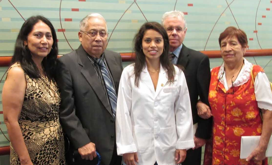 Courtney Gianninni is shown with her family during White Coat Ceremony.