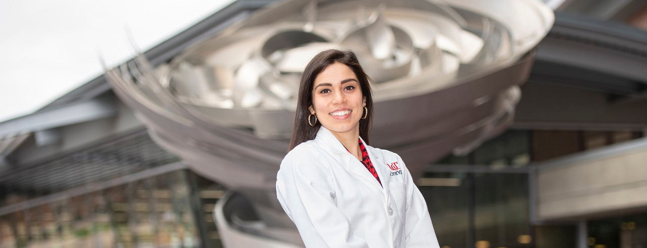Courtney Giannini is shown in front of the UC College of Medicine.