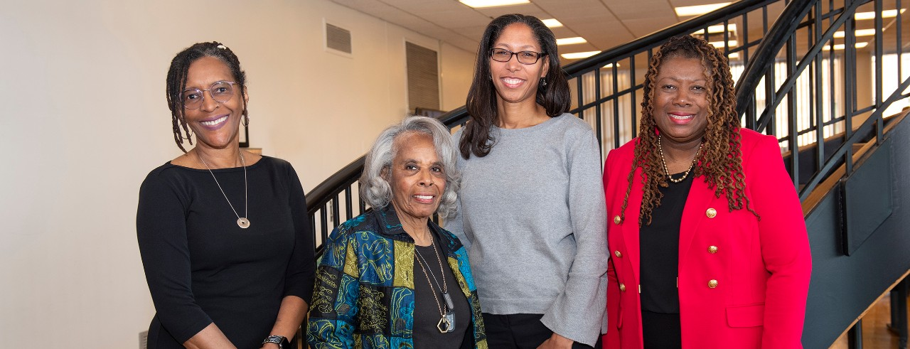Donna Shambley-Ebron, Jean Anthony, Holly Jones and Adelaide Harris on the spiral staircase in the UC College of Nursing