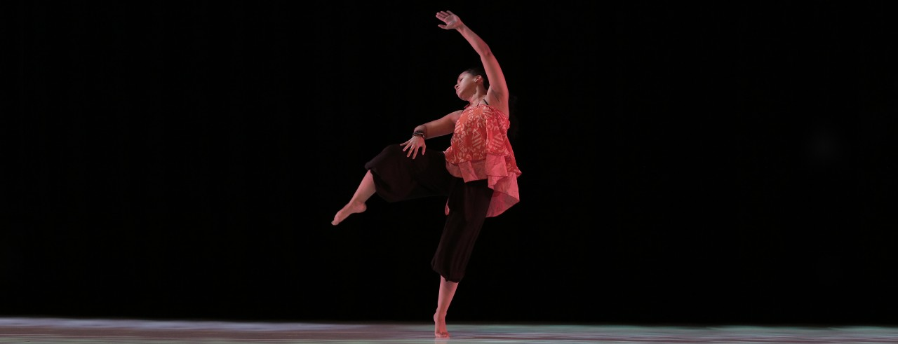 A photo of incoming CCM faculty member Shauna Steele dancing against a dark backdrop.