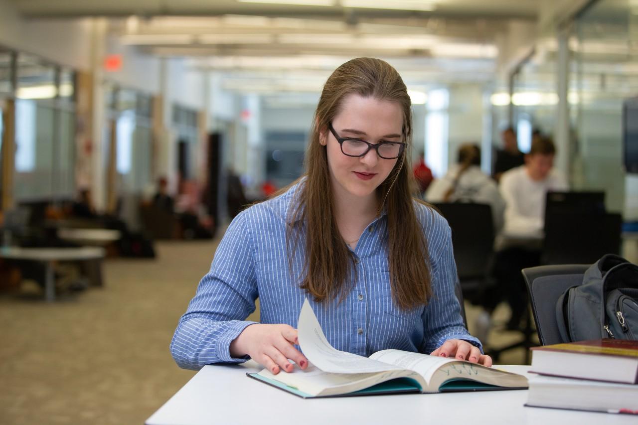 Laura Stegner studies in UC's engineering library in Rhodes Hall.
