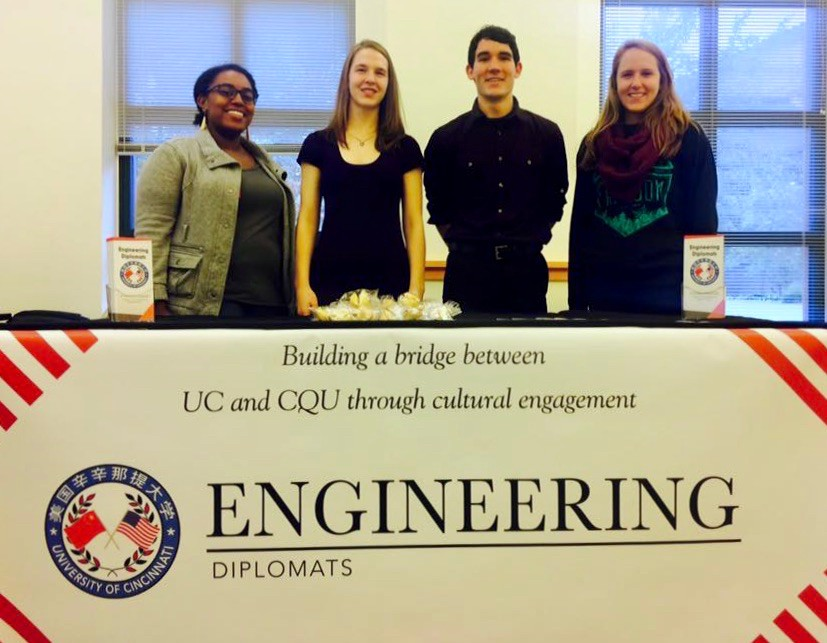 Laura Stegner and engineering classmates stand behind their Engineering diplomats banner.