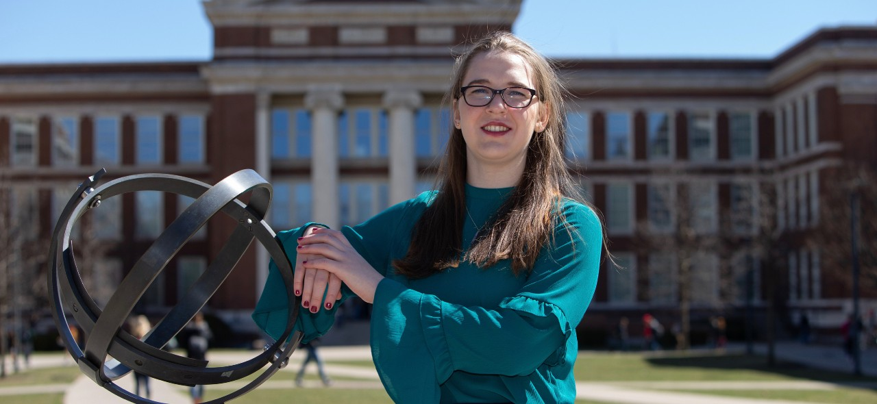 UC engineering student Laura Stegner stands in front of Baldwin Hall.