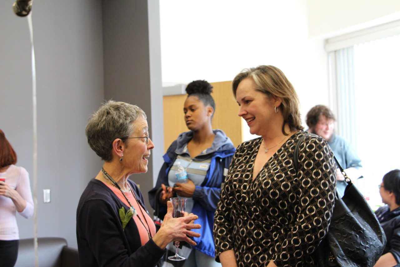 Picture of Joanna Mitro talking to friends at her retirement party on campus