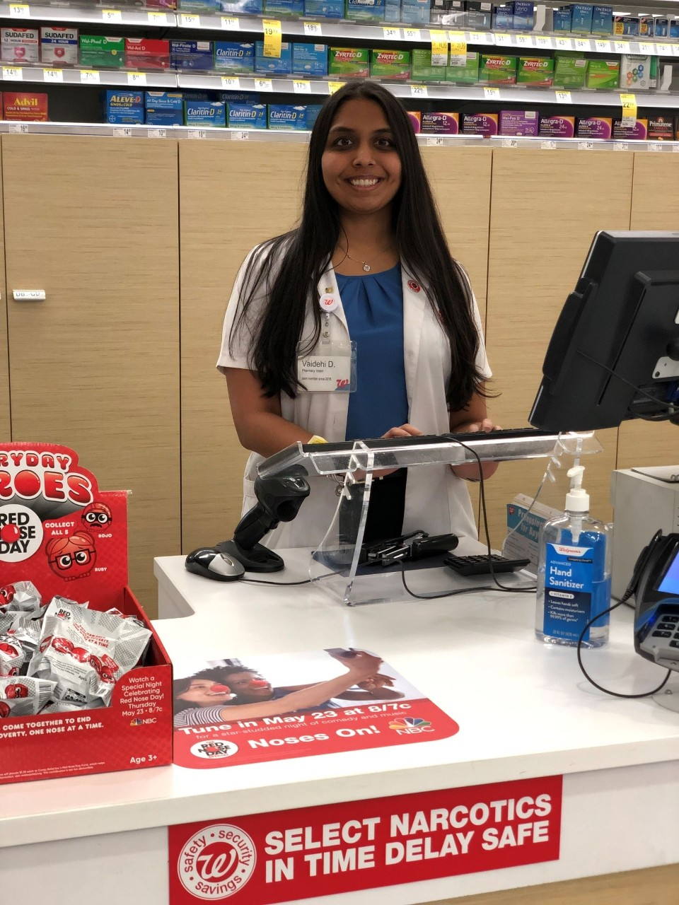 Specialty pharmacy resident Vaidehi Desai, behind the counter of a Walgreens pharmacy where she worked as an intern.