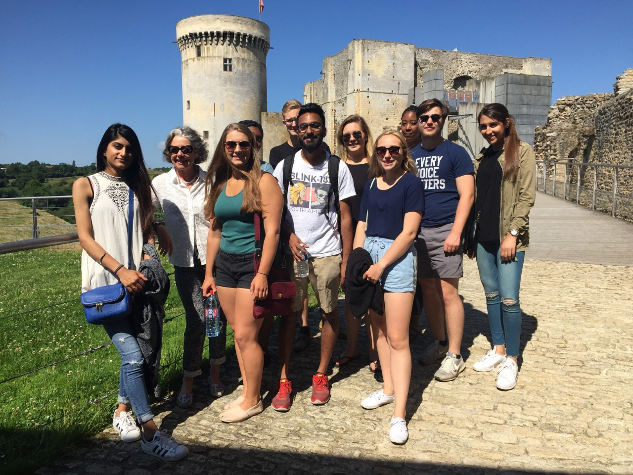 Andrea Ori and students in the UC Study Abroad Program shown at the castle of William the Conqueror in Normandy, France.