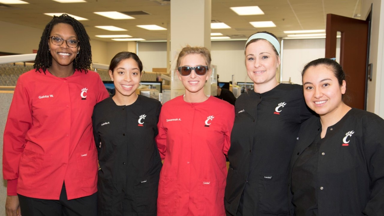 Savannah Allen with four fellow dental hygienists in the lab