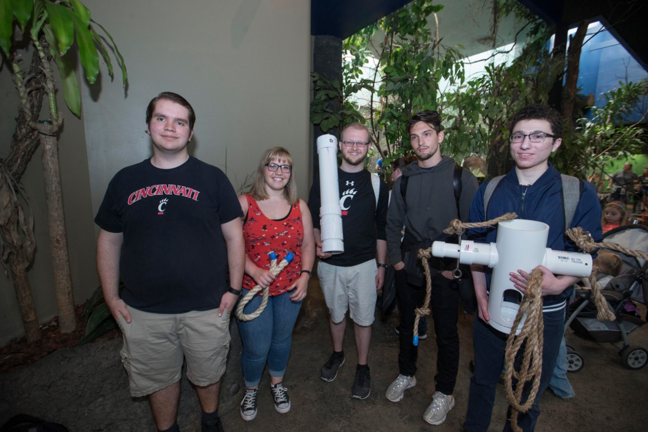 A group of students hold up their two enrichment devices.