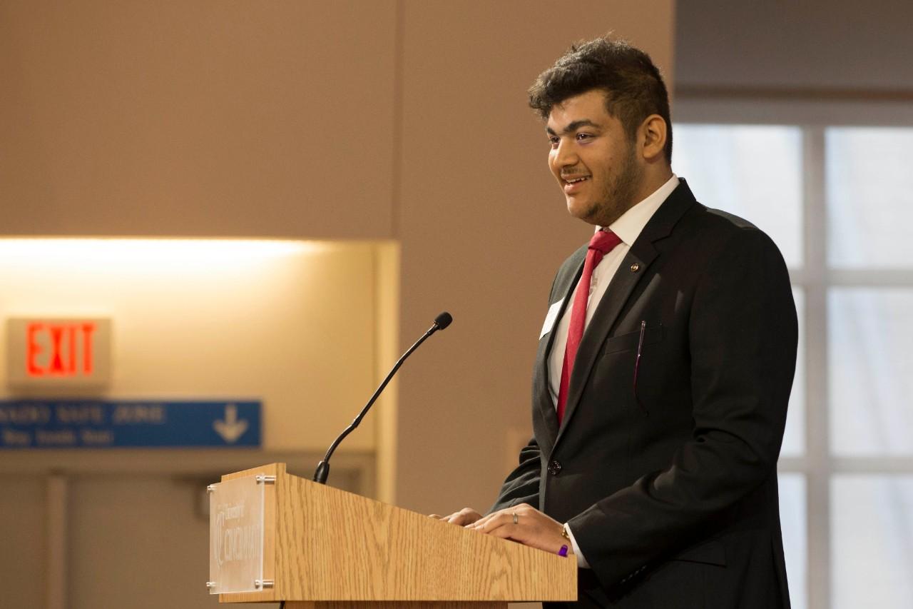 Prateek Srivastava speaks at a podium