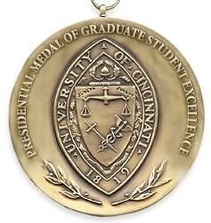 Close-up of UC's Presidential Medal of Graduate Student Excellence.