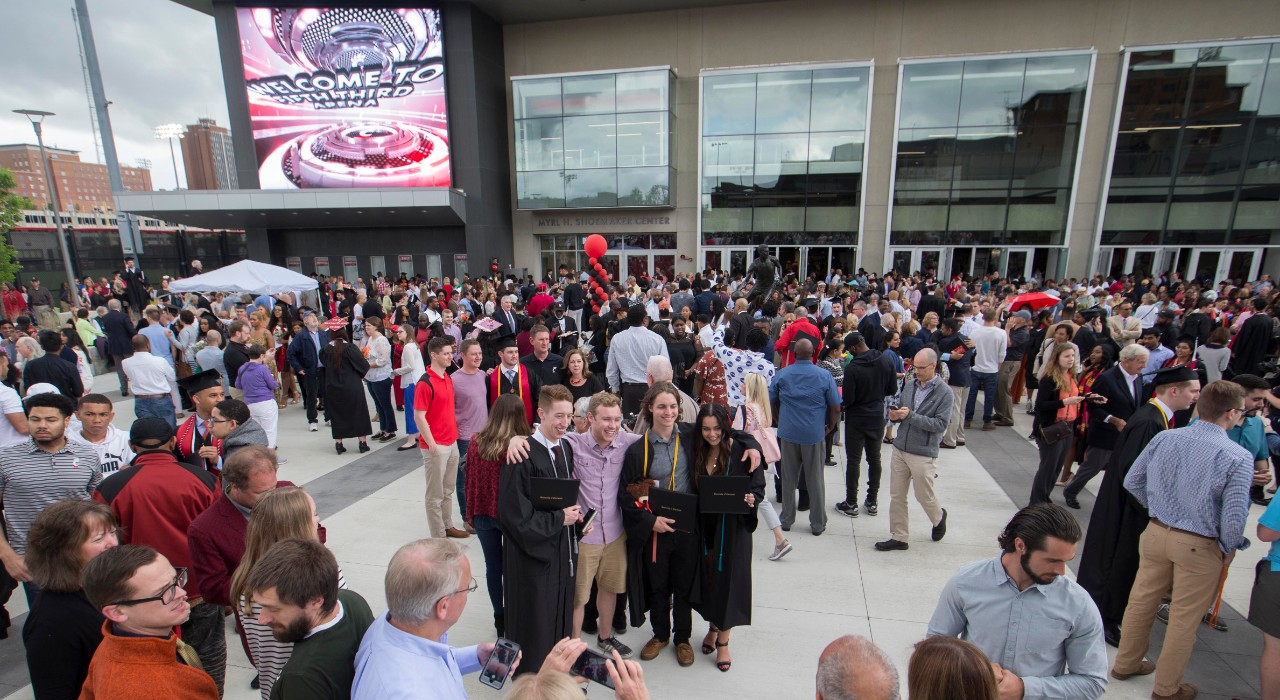 A crowd gathers outside the arena.