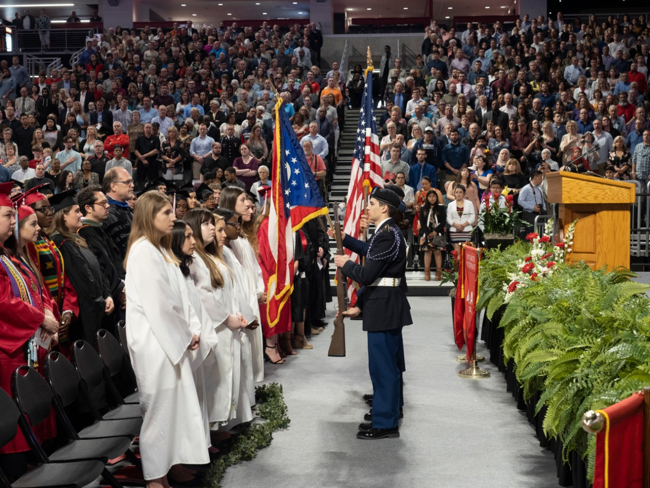 The scene on stage during the presentation of the colors at Fifth Third Arena.