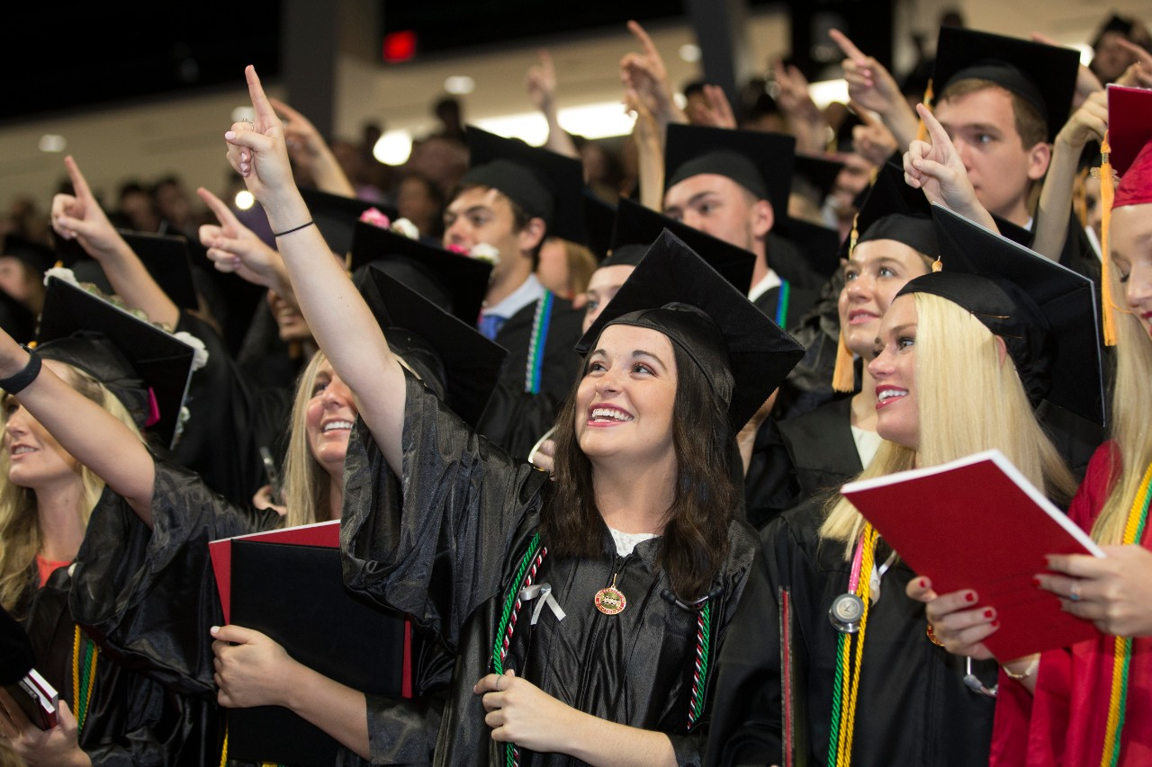 Students celebrate during commencement.