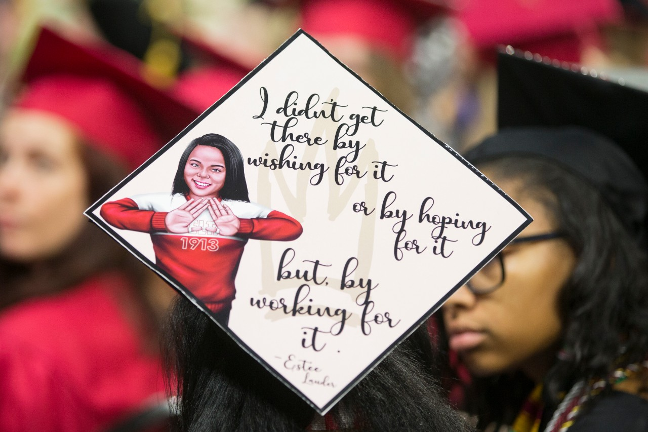 A mortarboard reads: I didn't get there by wishing for it or by hoping for it but by working for it.