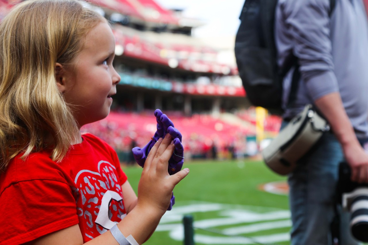 Ella Morton holds her hands together on the field at Great American Ball Park.