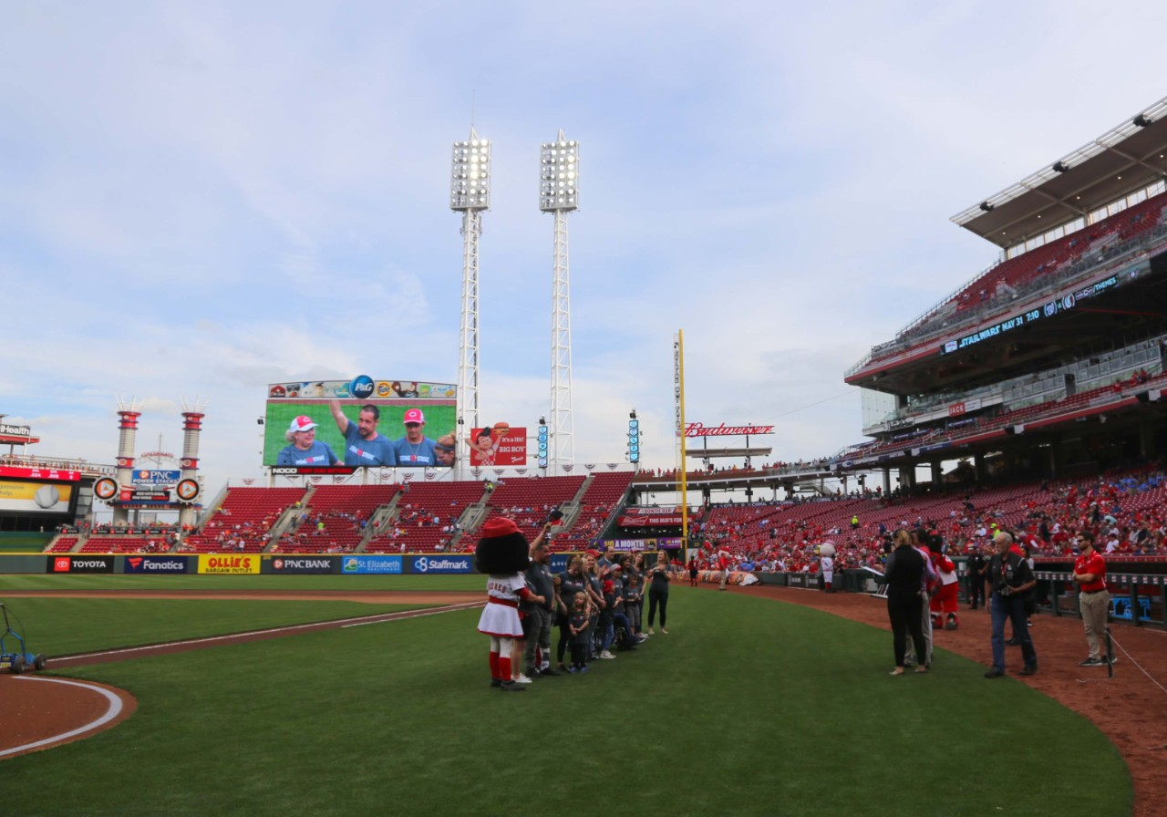 A group of honorary dignitaries lines up for photos at Great American Ball Park.