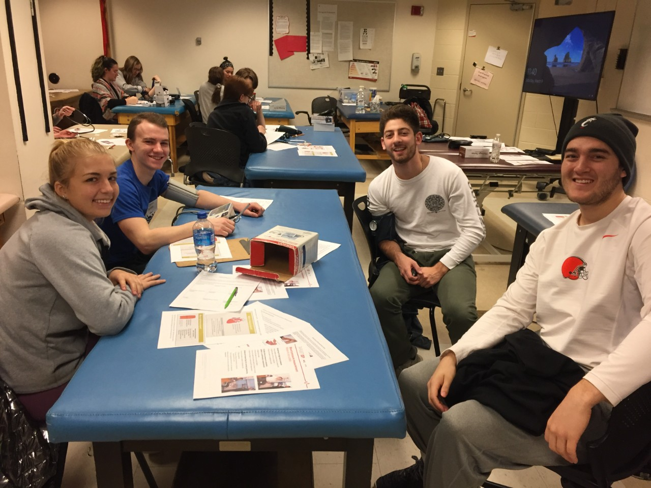Interdisciplinary group of students work together during Allied Health Race