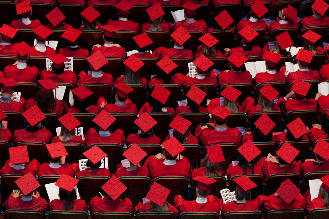 Ariel view of grads wearing red caps