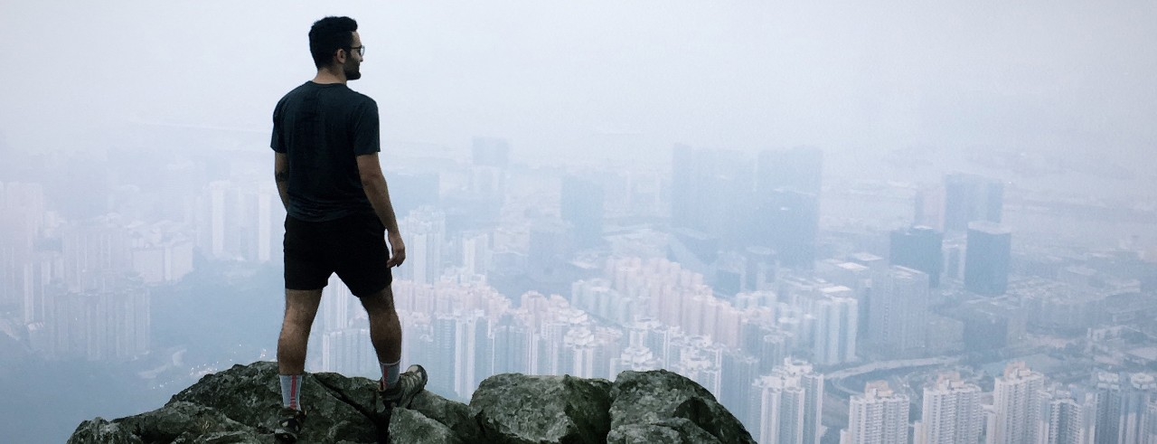 Rash Abdelwahed stand on a mountain overlooking the city of Hong Kong.