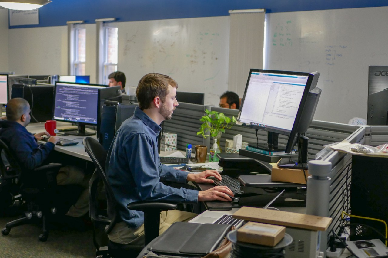 workers in predictronics open lab space