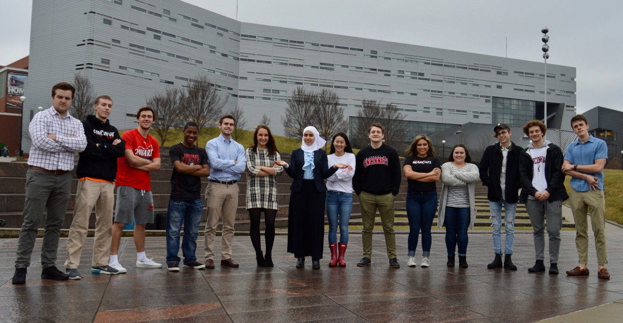 Mariam Elgafy stands on UC's campus with the Peer Leading group.